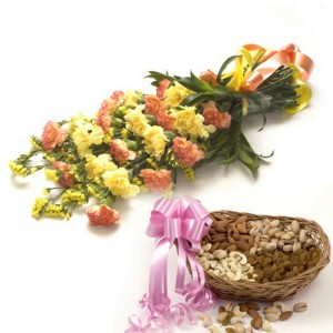 A bunch of carnations and a basket of mixed dry fruits