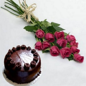 A simple bunch of red roses and a chocolate cake