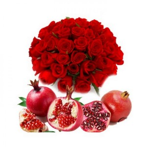bunch of red roses with fresh pomegranates