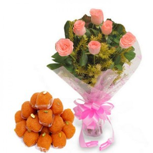 The orange ladoo and pink roses