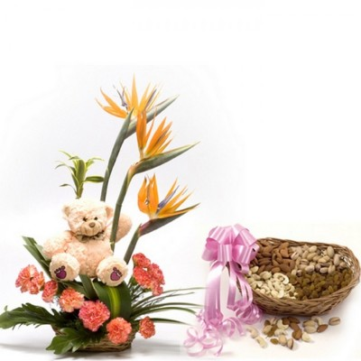 combo of orange carnations, bird of paradise flowers and a teddy Bear with a basket